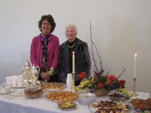 Ellen and Betty serve as hostesses.
