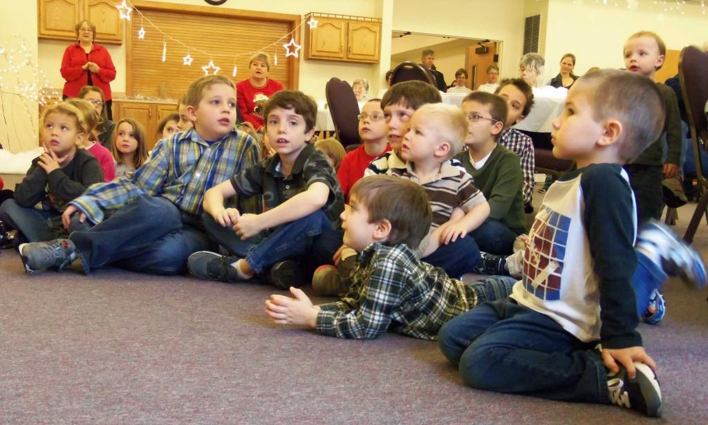 Children listen to the Chrismas Angel.