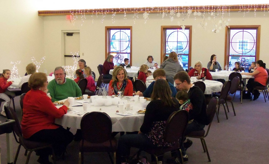 Families gathered for Breakfast with the Christmas Angel.