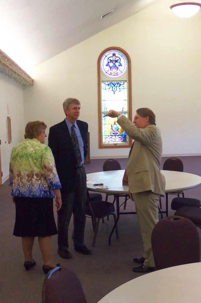 Pastor Phillip talks with Bob and Mary Swope