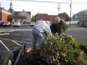 Richard and Doug load the wagon with clippings.