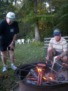 Art and Richard roast perfect hot dogs.
